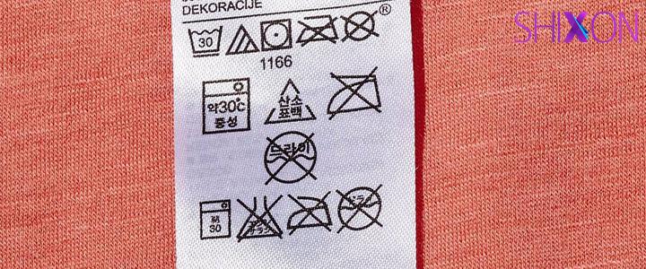 علامت های پشت لباس به چه معناست؟